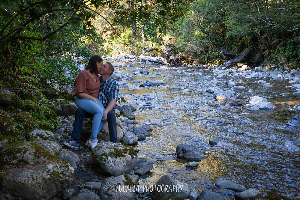 couple kissing by river, Mt Holdsworth, Wairarapa wedding photographer