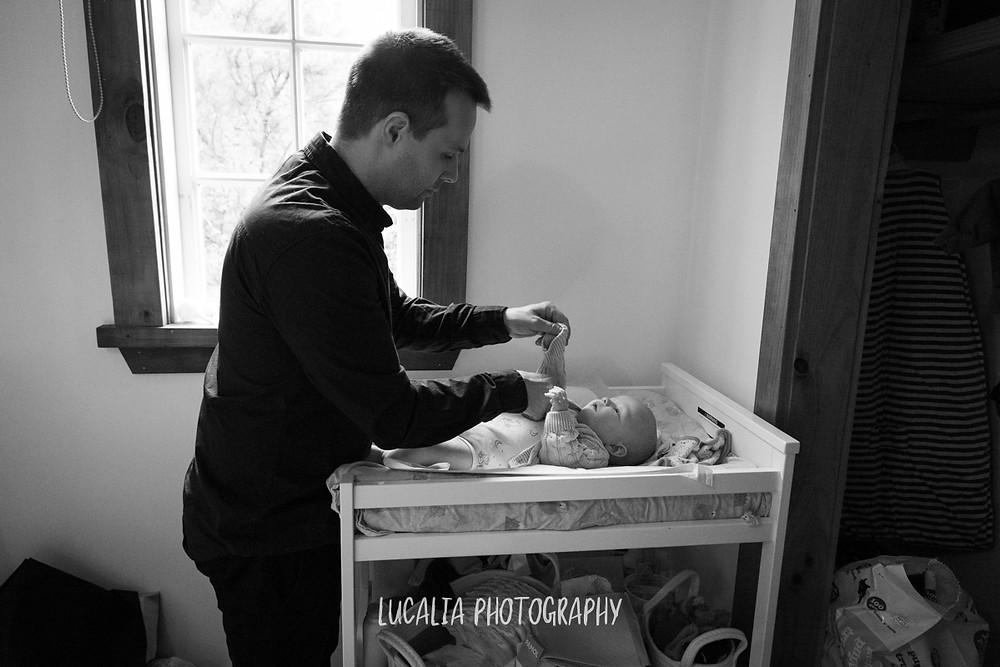 dad dressing baby son, Mount Holdsworth, Wairarapa family photographer
