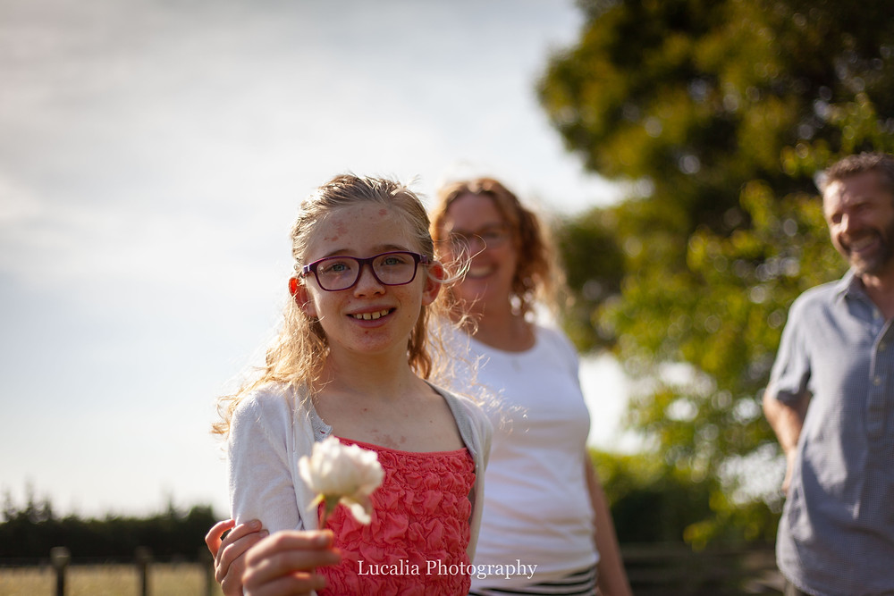 daughter shows a flower she has picked, Wairarapa family photographer