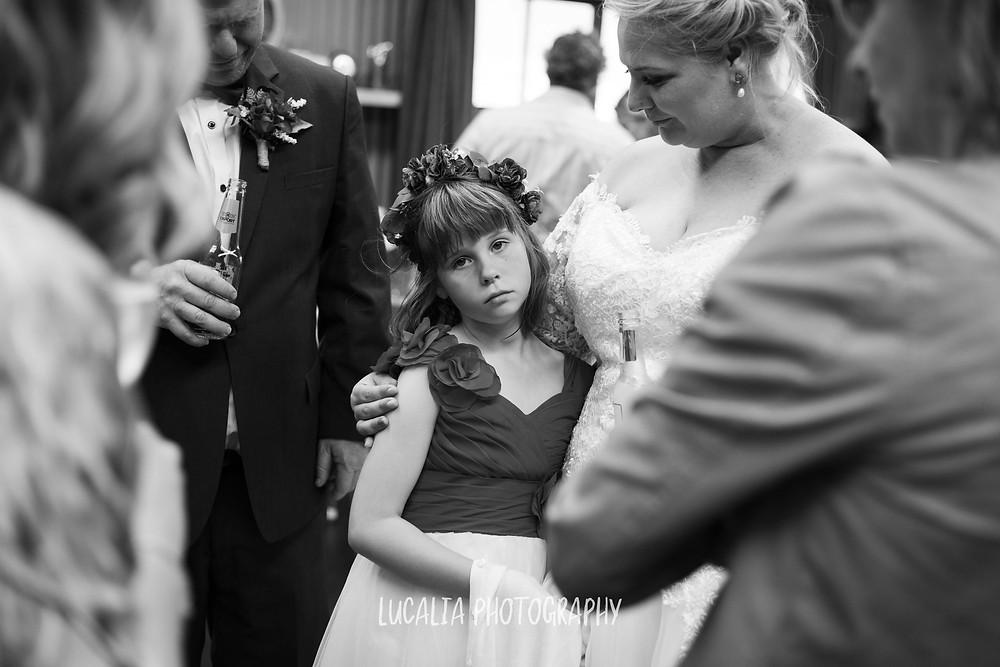 junior bridesmaid with bride at wedding reception, Waimeha Bar and Grill, Ngawi Wairarapa wedding photographer