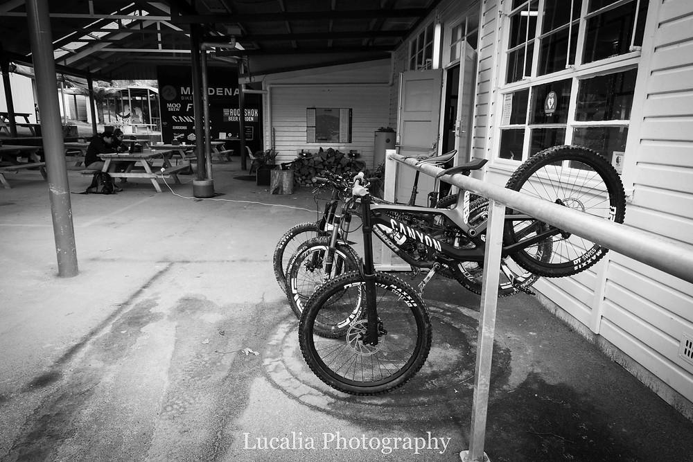 Mountain bikes hanging up outside Maydena Bike Park