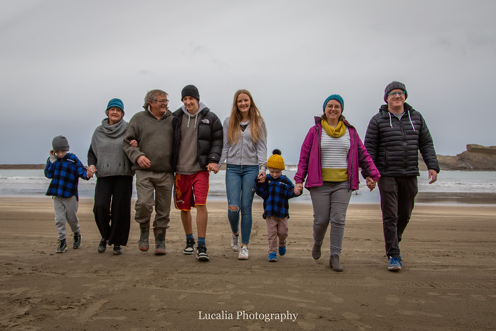extended family walking along the beach, Castlepoint Wairarapa family photographer