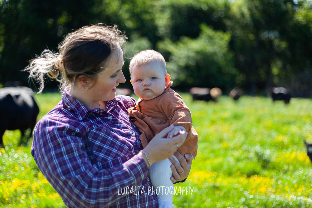 mum holding daughter in cow field, Wairarapa family photographer