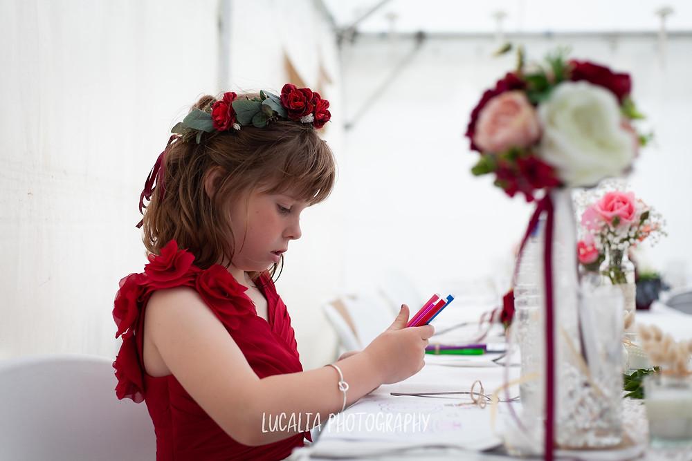 junior bridesmaid colouring in at wedding reception, Waimeha Bar and Grill, Ngawi Wairarapa wedding photographer