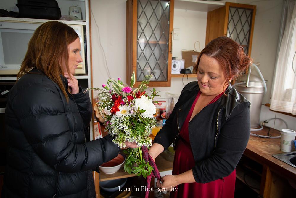 preparing wedding flowers, Wairarapa wedding photographer