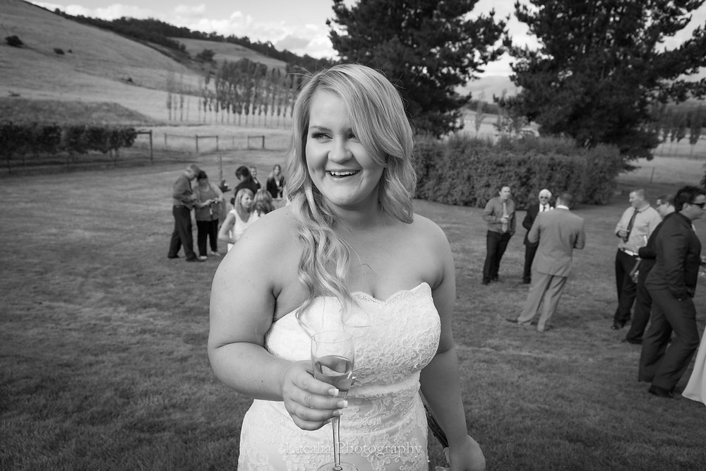 bride holding champagne at her outdoor wedding