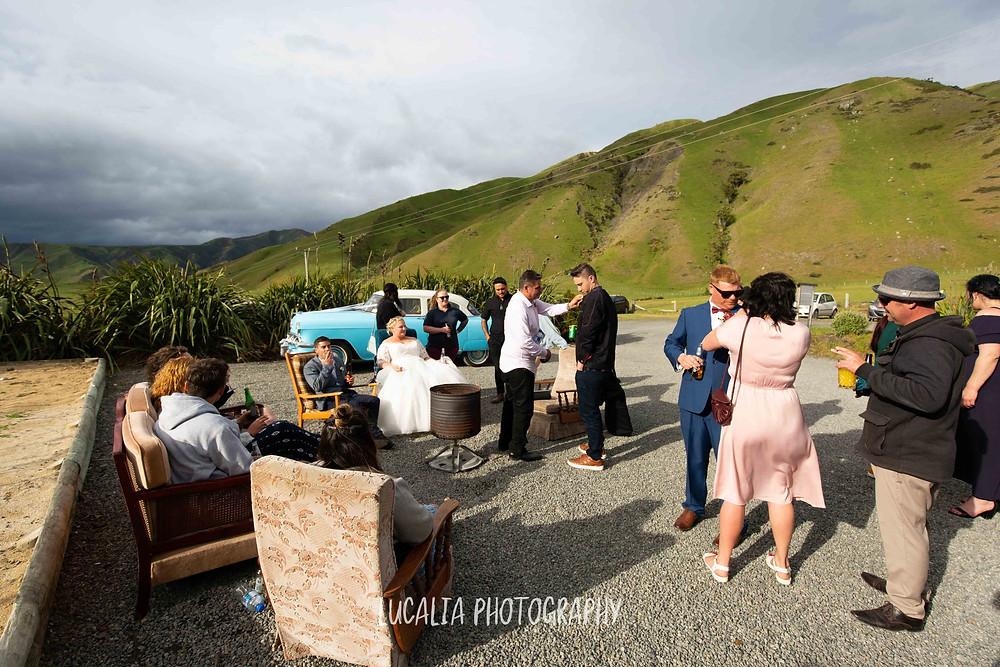wedding guests sitting outside at Waimeha Bar and Grill, Ngawi Wairarapa wedding photographer
