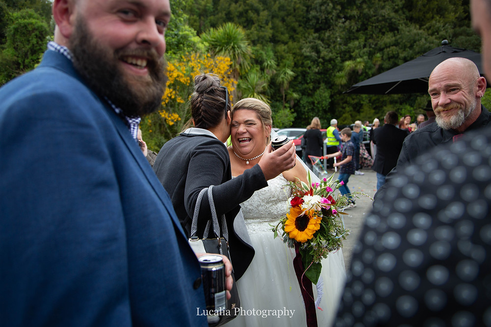 laughing guests and bride, Wairarapa wedding photographer