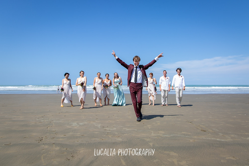 groom walks in front of wedding party, Castlepoint Wairarapa wedding, Lucalia Photography