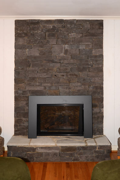 Before: faux black stone surrond at the fireplace.