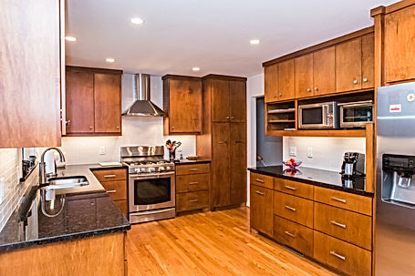 After: the kitchen's cherry wood cabinets are in keeping with the era - natural wood cabinetry was often seen used in mid century modern houses.