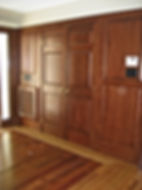 After: we lined the new entry foyer with cherry wood panelling.