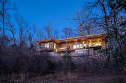 Haw River House view from river bank twi