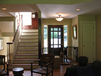After: the old entry was too small in proportion to the great room.
