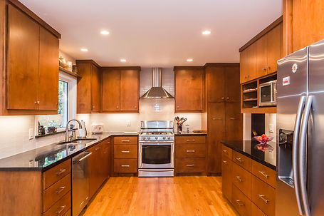 After: the new kitchen is sleek and has plenty of storage.