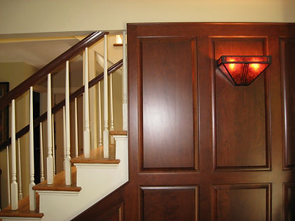 After: the new panelling we designed.  The light fixture is made with mica.