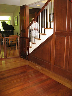 After: We custom designd the panelling around the existing stairs and put an inset of cherry wood on the floor to match.