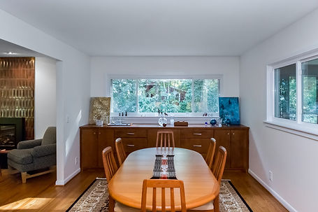 After: the dining room is opening up, making it brighter and more welcoming.