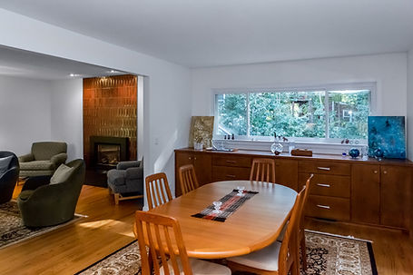 After: the dining room is no longer closed off, yet it retains its identity.
