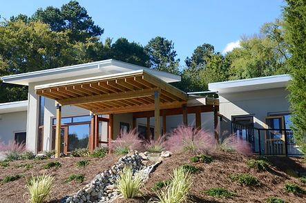 The Happy Meadows' Courtyard House has a screen porch that extends into the landscape.