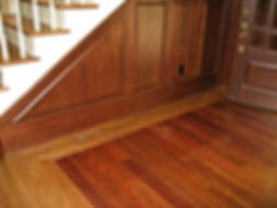 After: the cherrywood panelling is echoed with a cherry inset in the oak floor.