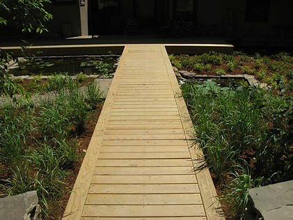 After: the elevated wood entry bridge.