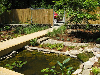 """After: an elevated """"bridge"""" element becomes the front walkway."""