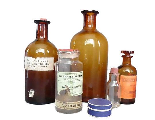 Botellas y botes de vidrio de farmacia antiguos