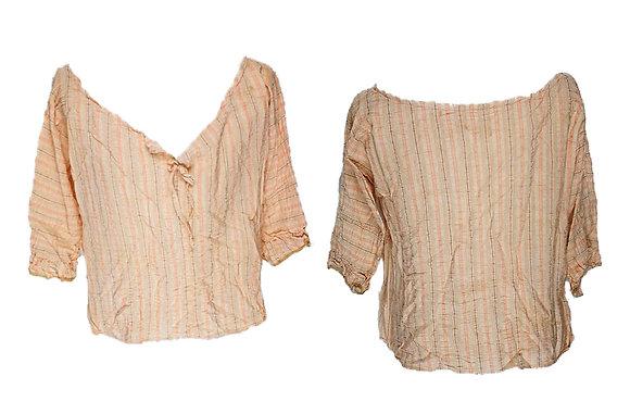 Blusa de tejido ligero con amplio escote