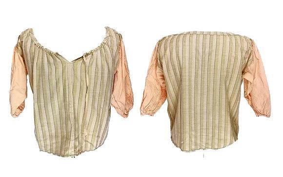 Blusa en dos colores con escote amplio y cierre de cordones