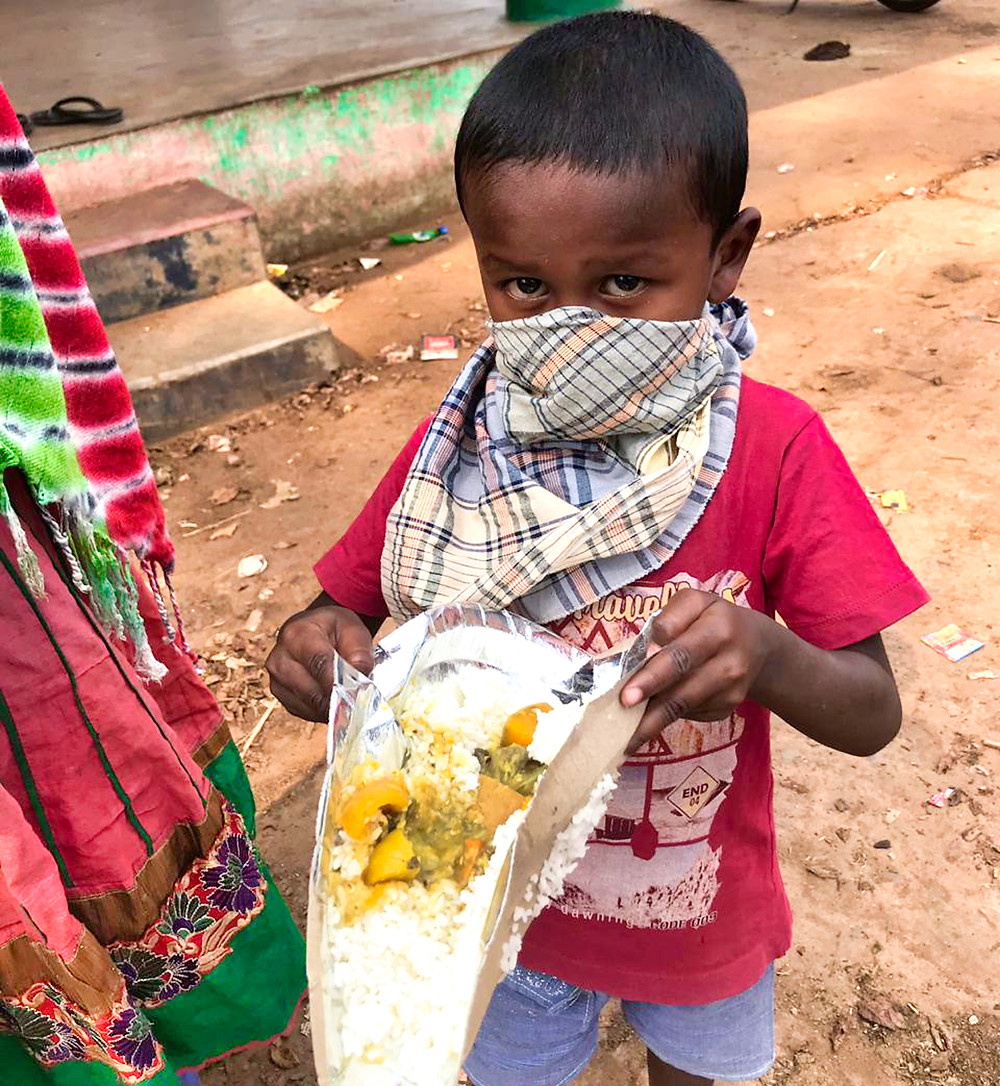 Child with mask and food