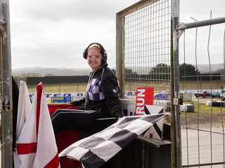 Sammy Brenton waving through drivers at the St Day Race Track