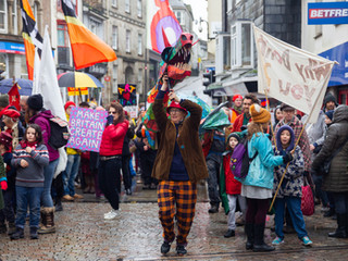 """Camborne, Reduth And Hayle Labour Party march down the streets of Reduth making a colourful and dramatic statement that """"art matters"""". 24/11/10"""