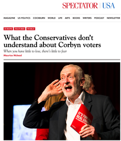 Labour leader Jeremy Corbyn cup- ping his ear at a climate change ral- ly in Falmouth, Cornwall 27/11/19, published in Spectator USA