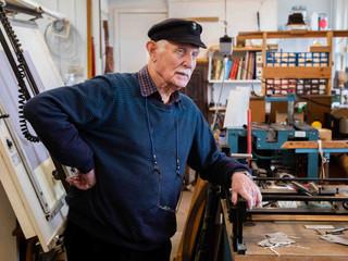 Colin Nunn in his clock repair shop