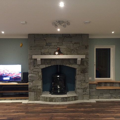 drystone fireplace and granite mantle