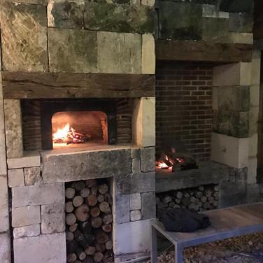 limestone and red brick pizza oven