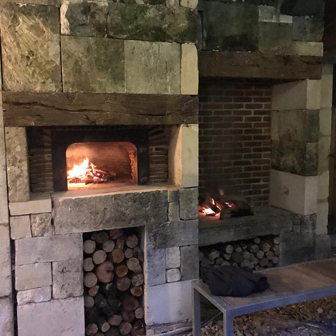 limestone and red brick pizza oven