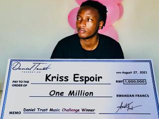 Kriss Espoir receives a Rwf1 million cash prize for winning The 2021 Daniel Trust Music Challenge