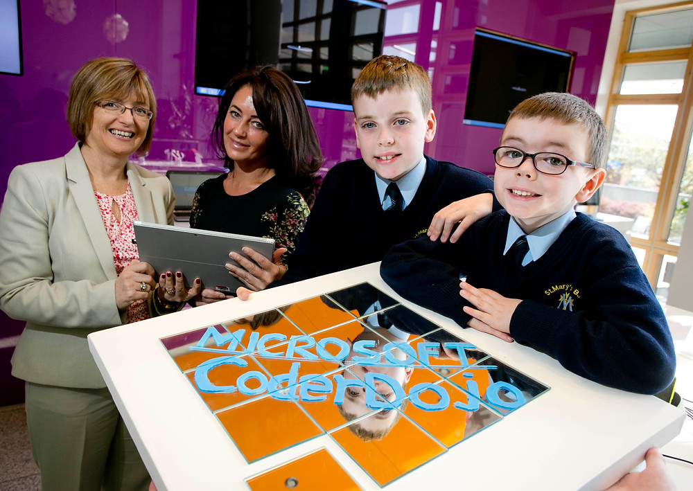 Eric and Elliot Meagher from St. Mary's Rathfarnham pictured with Cathriona Hallahan, MD, Microsoft Ireland and Mary Maloney, CEO, CoderDojo Foundation