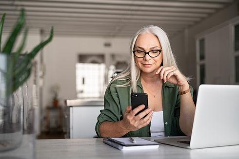 bigstock-Happy-senior-woman-using-mobil-