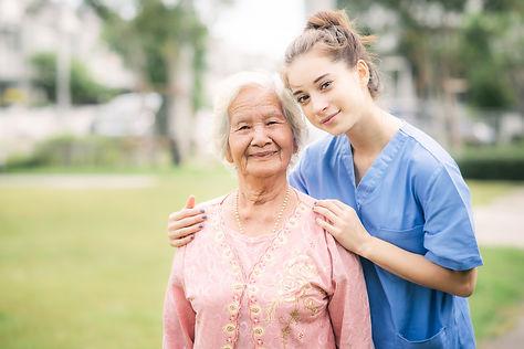 bigstock-Smiling-Nurse-Caregiver-With-A-