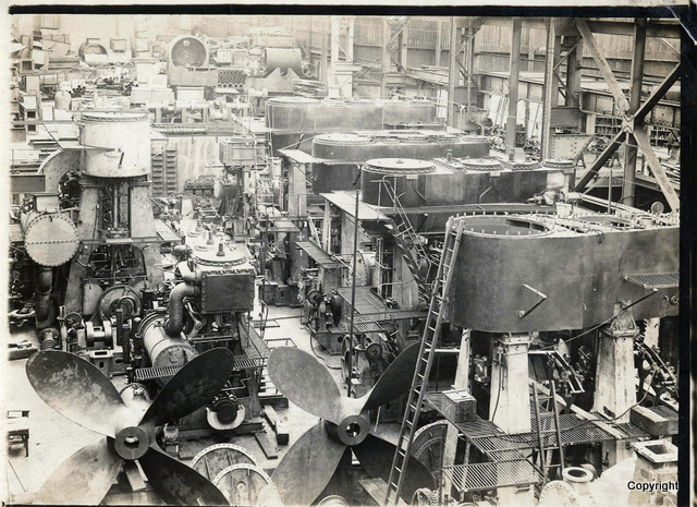 Image shows at least 7 steam engines, mainly triple expansion engines in the E shop, East Hamilton S
