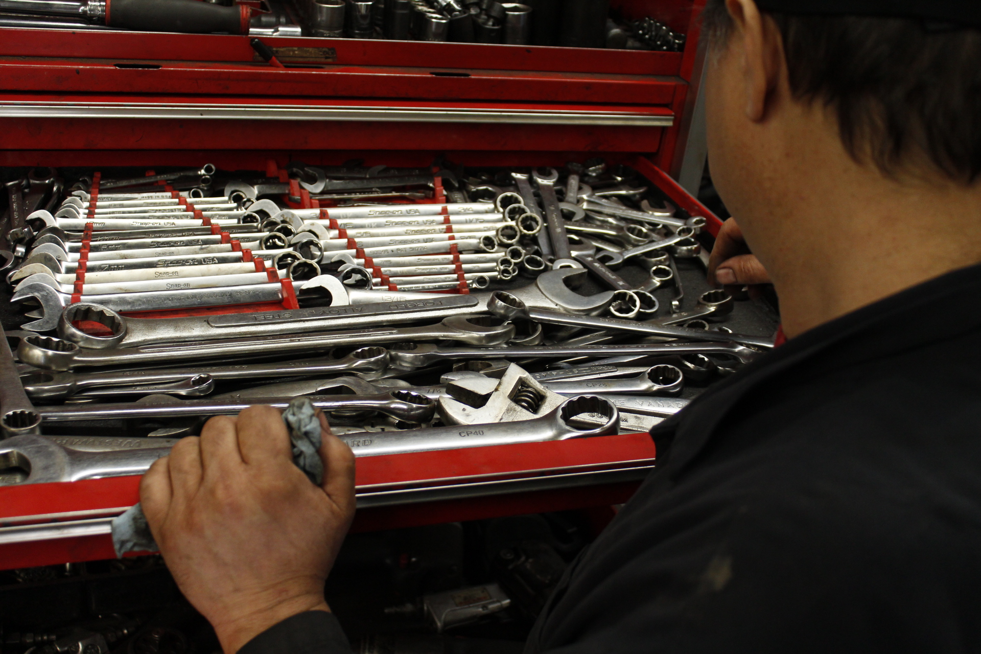 Dave searches through his wrenches