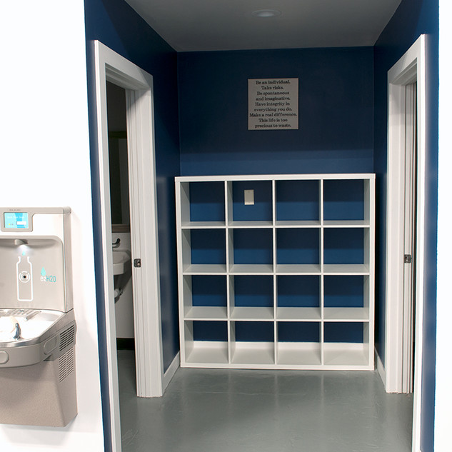 Two Gender Neutral Bathroom, Bag Storage Area, and Watder Fountain with Bottle Refill Station