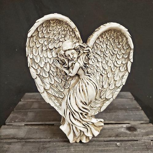 Female Angel Sleeping on Wings