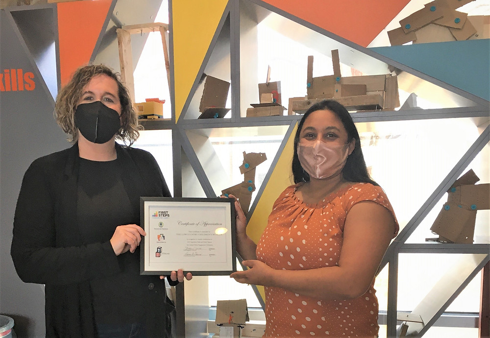 Parents As Teachers Parent Educator Lisa Van Dort (R) presents Children's Museum of the Lowcountry Executive Director and CCFS Partnership Board Member Nichole Myles (L) with a Certificate of Appreciation for participating in our annual Father Engagement Event and donating family admission passes.
