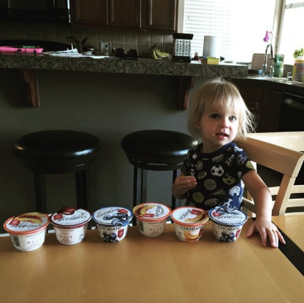 Dotchie (3yo) with his line up of greek yogurts.