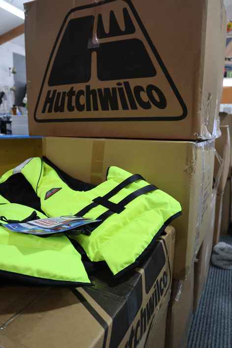 Boxes of lifejackets are in store. Everyone on the boat must have a life jacket that is suitable for purpose, the right size and a snug fit.