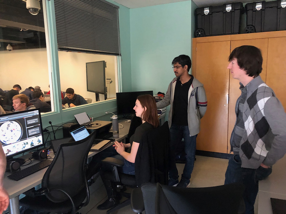 Members of the research team watching the classes